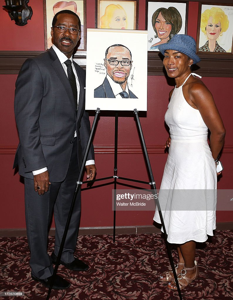 Courtney B. Vance and wife Angela Bassett attend Vance's caricature unveiling at Sardi's on July 2, 2013 in New York City.