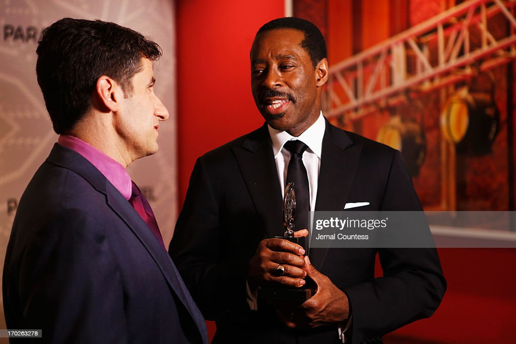 Courtney B. Vance (R), winner of the award for Best Performance by a Featured Actor in a Play for 'Lucky Guy', attends The 67th Annual Tony Awards Paramount Hotel Winners' Room at Radio City Music Hall on June 9, 2013 in New York City.