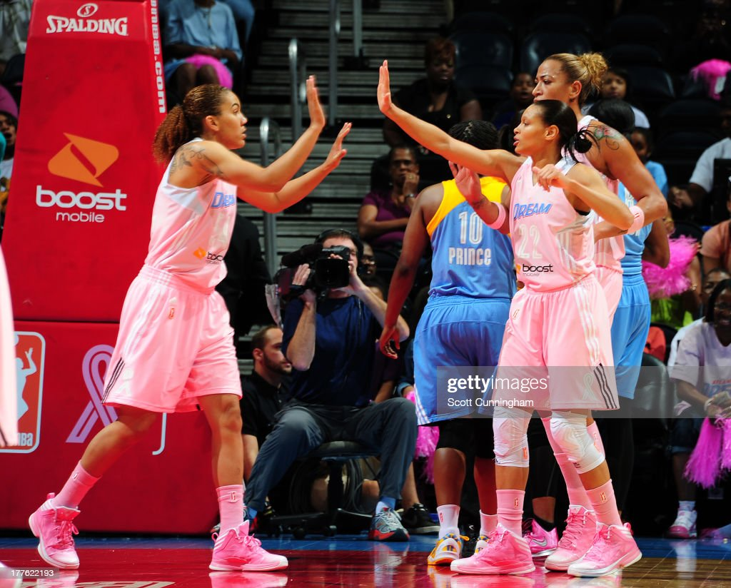 Courtney Clements #54 and Armintie Herrington #22 of the Atlanta Dream celebrate after a score against the Chicago Sky at Philips Arena on August 24 2013 in Atlanta, Georgia.
