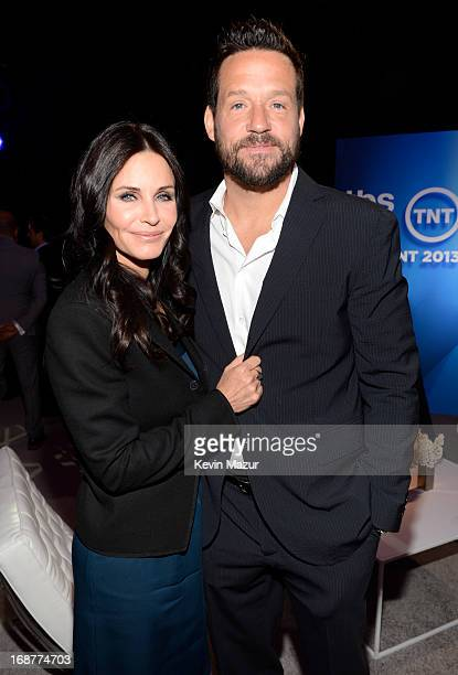 Courtney Cox and Josh Hopkins attend the 2013 TNT/TBS Upfront at Hammerstein Ballroom on May 15 2013 in New York City 23562_002_0401JPG