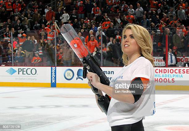 Courtney Crossett of the Philadelphia Flyers ice girls shoots tshirts into the crowd during the intermission against the Boston Bruins on January 13...