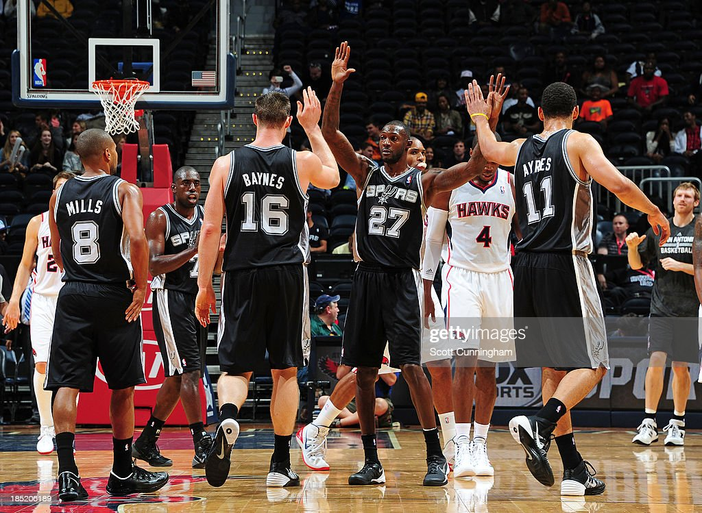 <a gi-track='captionPersonalityLinkClicked' href=/galleries/search?phrase=Courtney+Fells&family=editorial&specificpeople=799959 ng-click='$event.stopPropagation()'>Courtney Fells</a> #27 of the San Antonio Spurs celebrates with his team during the game against the Atlanta Hawks on October 17, 2013 at Philips Arena in Atlanta, Georgia.