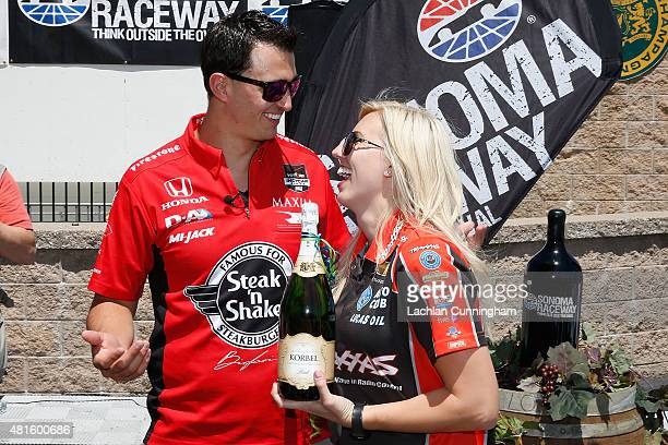 Courtney Force NHRA's winningest female driver celebrates winning a grape stomping contest against her fiance INDYCAR driver Graham Rahal during a...