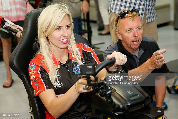 Courtney Force NHRA's winningest female driver gets advice from an instructor as she races a racing simulator against her fiance INDYCAR driver...