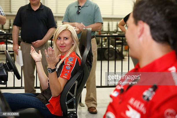 Courtney Force NHRA's winningest female driver races a racing simulator against her fiance INDYCAR driver Graham Rahal during a racing skills...