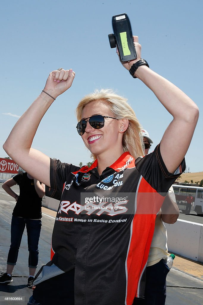 <a gi-track='captionPersonalityLinkClicked' href=/galleries/search?phrase=Courtney+Force&family=editorial&specificpeople=8957288 ng-click='$event.stopPropagation()'>Courtney Force</a>, NHRA's winningest female driver, races a remote controlled car against her fiance, INDYCAR driver Graham Rahal (not pictured), during a racing skills challenge at Sonoma Raceway on July 22, 2015 in Sonoma, California.