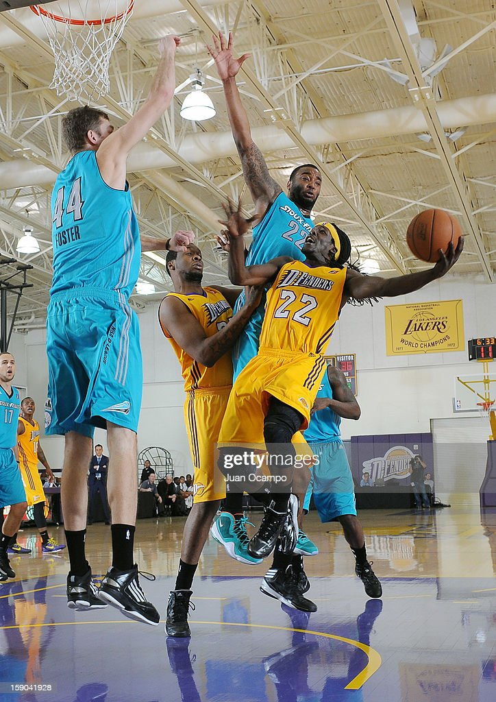 Courtney Fortson #22 of the Los Angeles D-Fenders goes to the basket against <a gi-track='captionPersonalityLinkClicked' href=/galleries/search?phrase=Arnett+Moultrie&family=editorial&specificpeople=5759676 ng-click='$event.stopPropagation()'>Arnett Moultrie</a> #22 and Will Foster #44 of the Sioux Falls Skyforce on January 5, 2013 at Toyota Sports Center in El Segundo, California.