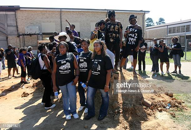 Courtney Fuller Jada Lillie and Nyesha Sanders of Durham North Carolina pose for a picture in the courtyard of Jena High School Thousands of people...