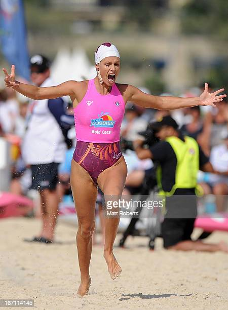 Courtney Hancock of Northcliffe SLSC celebrates winning the Open Ironwoman final during the 2013 Australian National Surf Lifesaving Titleson April...