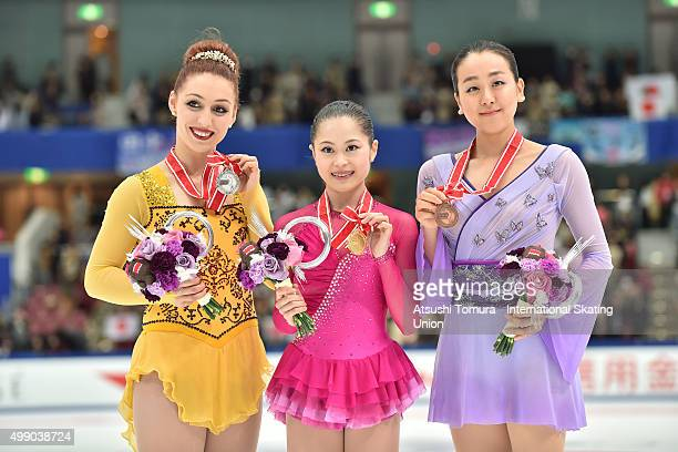 Courtney Hicks of the USA Satoko Miyahara and Mao Asada of Japan pose with medals during the day two of the NHK Trophy ISU Grand Prix of Figure...