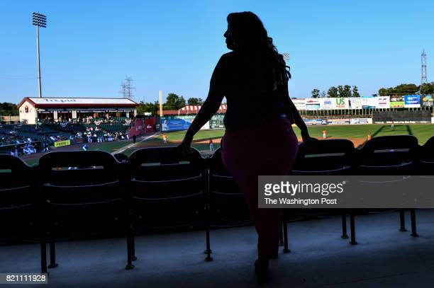 Courtney Knichel the general manager of the independent Southern Maryland Blue Crabs baseball team keeps an eye on things during a game at Regency...