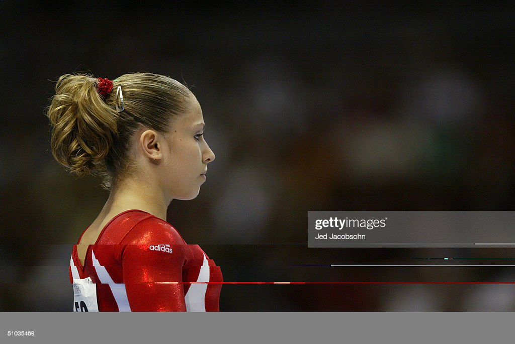 Courtney Kupets looks on during the Women's finals of the U.S. Gymnastics Olympic Team Trials on June 27, 2004 at The Arrowhead Pond of Anaheim in Anaheim, California.
