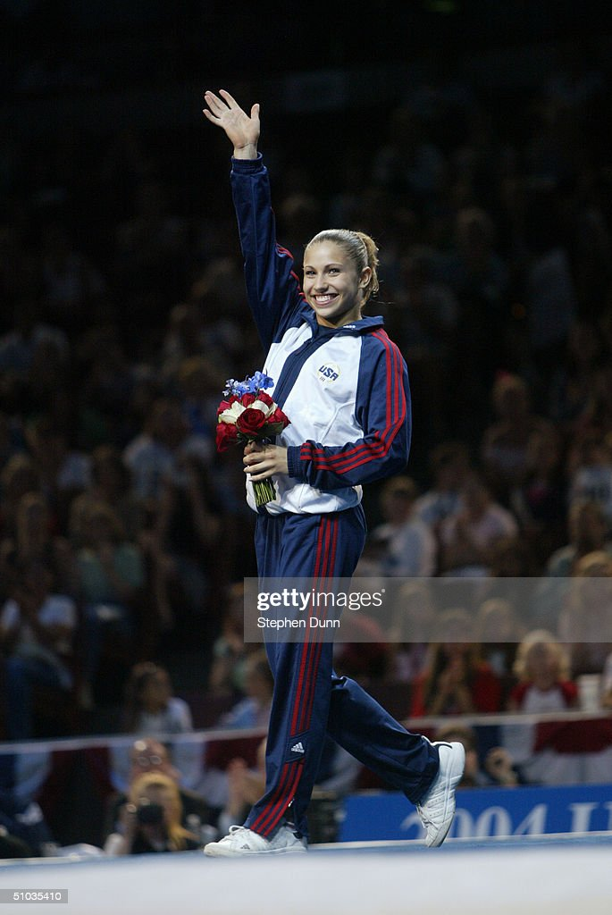 Courtney Kupets waves to the crowd after being named to the 2004 Olympic team following the Women's finals of the U.S. Gymnastics Olympic Team Trials on June 27, 2004 at The Arrowhead Pond of Anaheim in Anaheim, California.