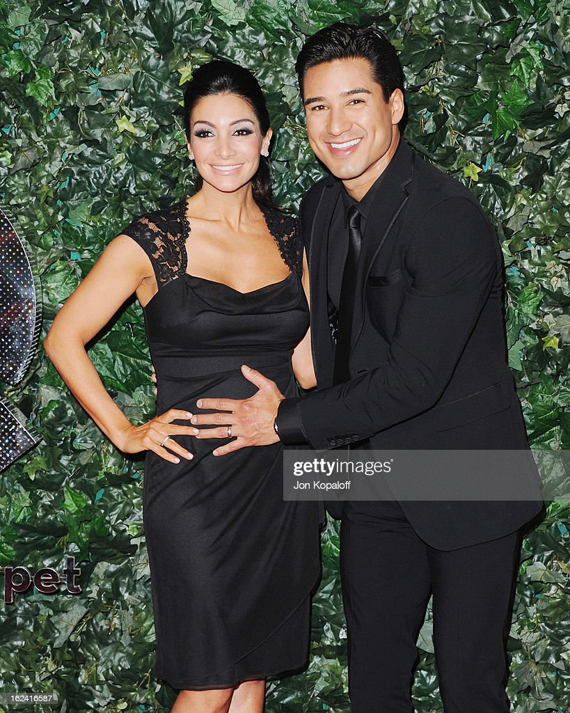 Courtney Laine Mazza and Mario Lopez arrive at the QVC Red Carpet Style Party at Four Seasons Hotel Los Angeles at Beverly Hills on February 22, 2013 in Beverly Hills, California.