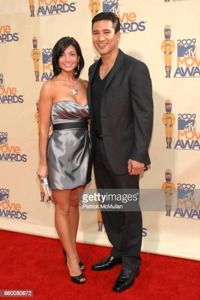 Courtney Laine Mazza and Mario Lopez attend 2009 MTV Movie Awards Arrivals at Gibson Amphitheatre on May 31 2009 in Universal City California