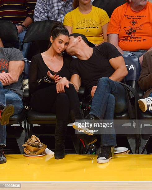 Courtney Laine Mazza and Mario Lopez attend a game between Golden State Warriors and the Los Angeles Lakers at Staples Center on November 9 2012 in...