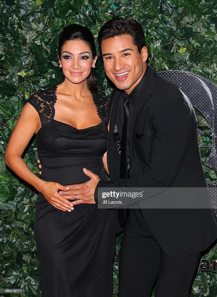 Courtney Laine Mazza and Mario Lopez attend the QVC 'Red Carpet Style' event at Four Seasons Hotel Los Angeles at Beverly Hills on February 22, 2013 in Beverly Hills, California.