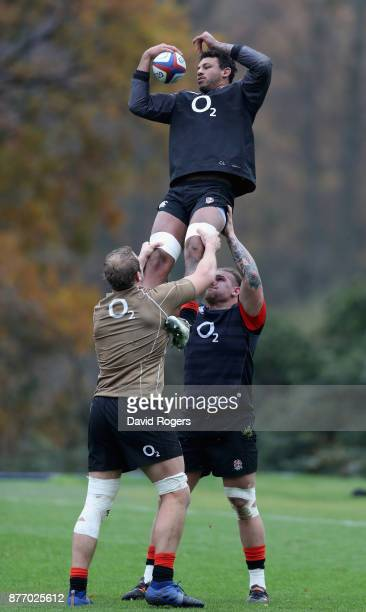 Courtney Lawes catches the ball as Joe Launchbury and Harry Williams assist during the England training session held at Pennyhill Park on November 21...