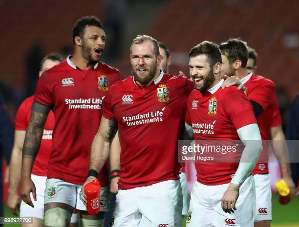 Courtney Lawes James Haskell and Elliot Daly of the Lions celebrate victory during the match between the Chiefs and the British Irish Lions at...