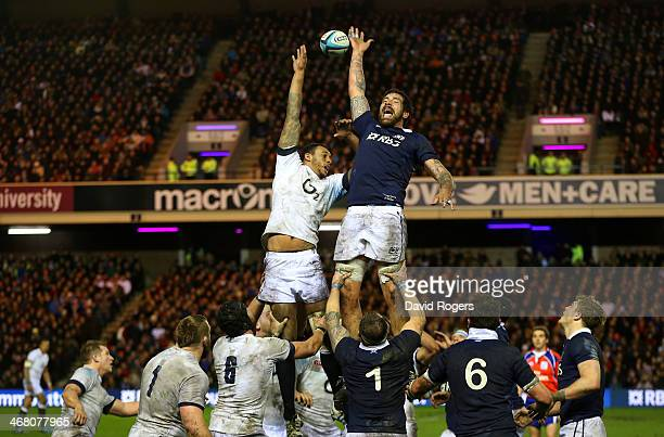 Courtney Lawes of England and James Hamilton of Scotland go up for the line out ball during the RBS Six Nations match between Scotland and England at...