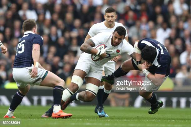 Courtney Lawes of England hands off Zander Fagerson of Scotland during the RBS Six Nations match between England and Scotland at Twickenham Stadium...