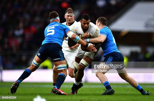 Courtney Lawes of England is challenged by Dries van Schalkwyk and Giorgio Bronzini of Italy during the RBS Six Nations match between England and...