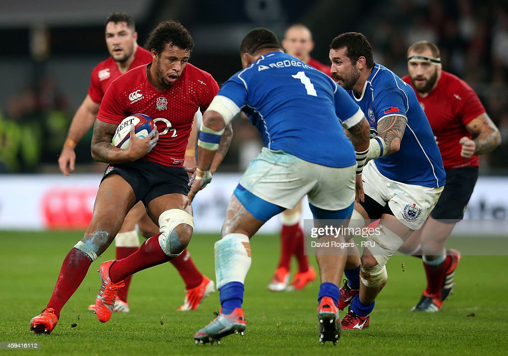 <a gi-track='captionPersonalityLinkClicked' href=/galleries/search?phrase=Courtney+Lawes&family=editorial&specificpeople=5385543 ng-click='$event.stopPropagation()'>Courtney Lawes</a> of England is challenged by <a gi-track='captionPersonalityLinkClicked' href=/galleries/search?phrase=Sakaria+Taulafo&family=editorial&specificpeople=6532773 ng-click='$event.stopPropagation()'>Sakaria Taulafo</a> of Samoa during the QBE international match between England and Samoa at Twickenham Stadium on November 22, 2014 in London, England.