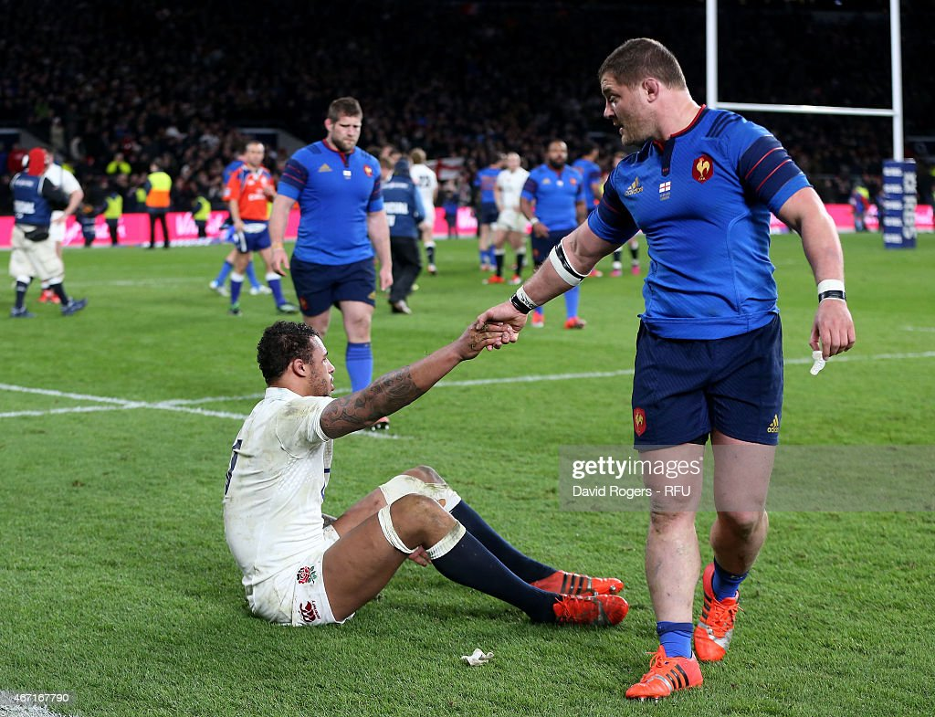 <a gi-track='captionPersonalityLinkClicked' href=/galleries/search?phrase=Courtney+Lawes&family=editorial&specificpeople=5385543 ng-click='$event.stopPropagation()'>Courtney Lawes</a> of England is helped up by <a gi-track='captionPersonalityLinkClicked' href=/galleries/search?phrase=Benjamin+Kayser&family=editorial&specificpeople=2117538 ng-click='$event.stopPropagation()'>Benjamin Kayser</a> of France at the end of the RBS Six Nations match between England and France at Twickenham Stadium on March 21, 2015 in London, England.