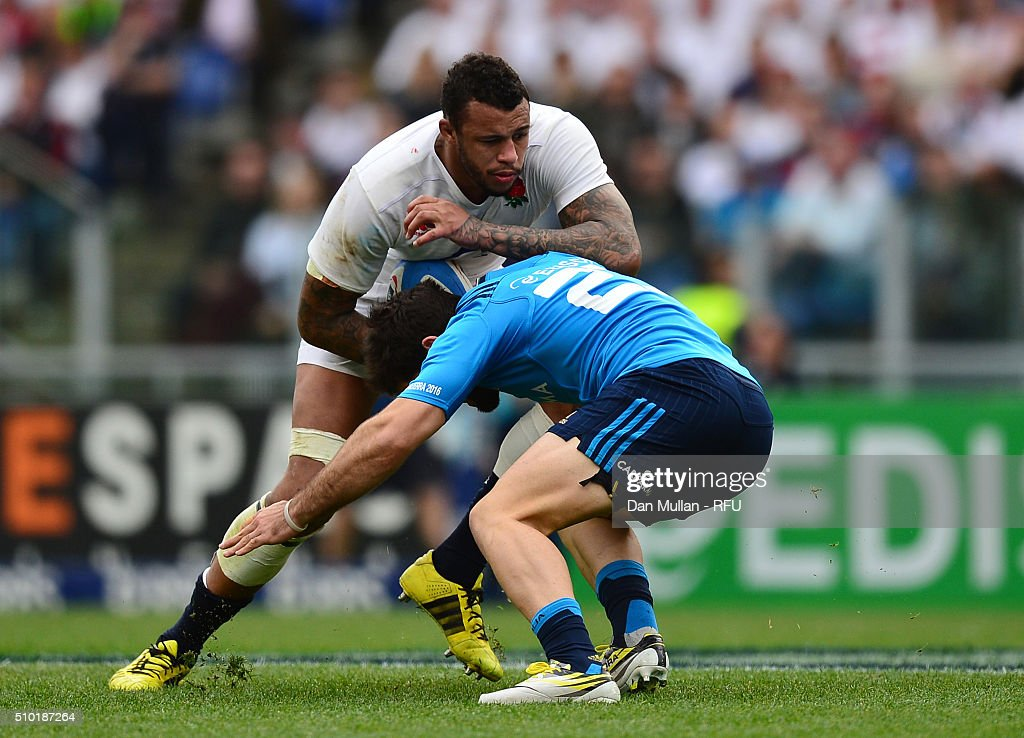<a gi-track='captionPersonalityLinkClicked' href=/galleries/search?phrase=Courtney+Lawes&family=editorial&specificpeople=5385543 ng-click='$event.stopPropagation()'>Courtney Lawes</a> of England is tackled by Andrea Pratichetti of Italy during the RBS Six Nations match between Italy and England at the Stadio Olimpico on February 14, 2016 in Rome, Italy.