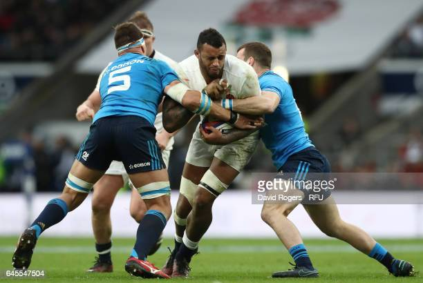 Courtney Lawes of England is tackled by Dries van Schalkwyk of Italy during the RBS Six Nations match between England and Italy at Twickenham Stadium...