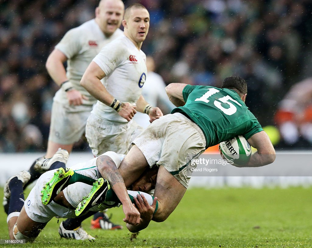 Courtney Lawes of England knocks himself unconcious making a tackle on Rob Kearney of Ireland during the RBS Six Nations match between Ireland and England at Aviva Stadium on February 10, 2013 in Dublin, Ireland.