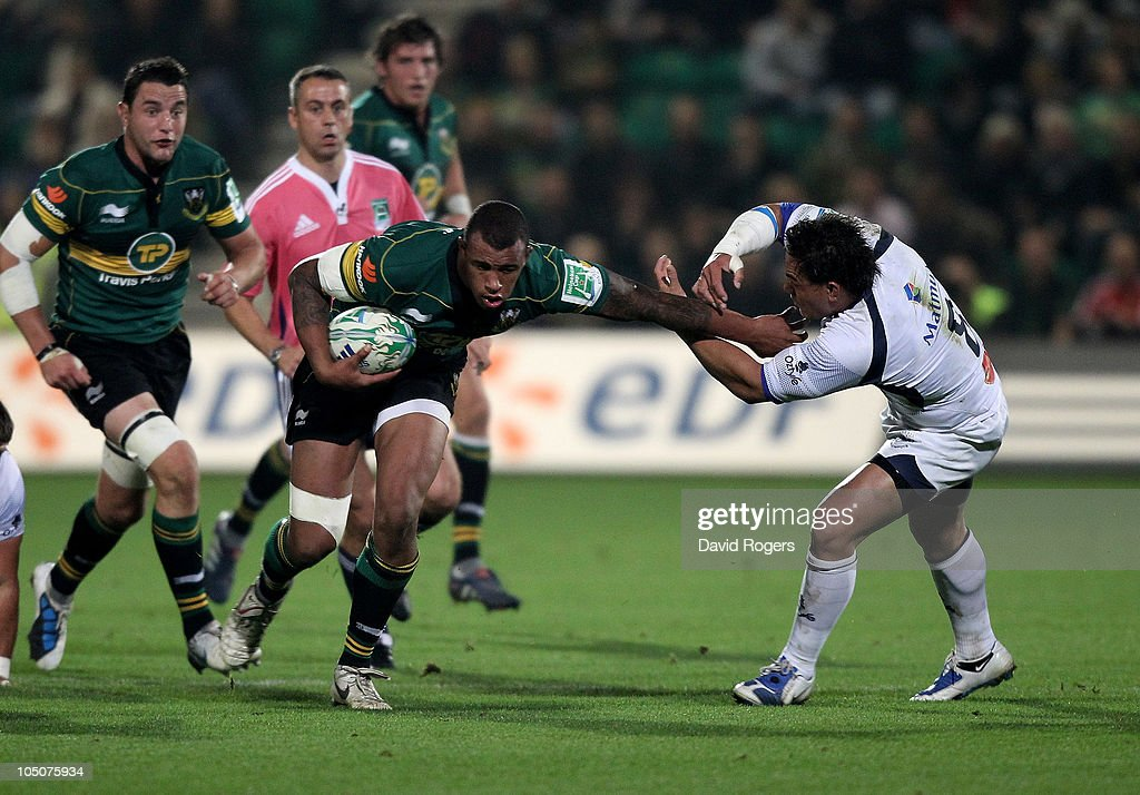 <a gi-track='captionPersonalityLinkClicked' href=/galleries/search?phrase=Courtney+Lawes&family=editorial&specificpeople=5385543 ng-click='$event.stopPropagation()'>Courtney Lawes</a> of Northampton holds off <a gi-track='captionPersonalityLinkClicked' href=/galleries/search?phrase=Chris+Masoe&family=editorial&specificpeople=540337 ng-click='$event.stopPropagation()'>Chris Masoe</a> during the Heineken Cup match between Northampton Saints and Castres Olympique at Franklin's Gardens on October 8, 2010 in Northampton, England.