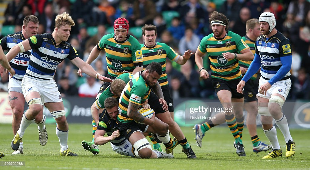 Courtney Lawes of Northampton is tackled during the Aviva Premiership match between Northampton Saints and Bath at Franklin's Gardens on April 30, 2016 in Northampton, England.