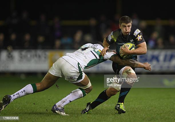 Courtney Lawes of Northampton tackled Sam Lewis of Ospreys during the LV= Cup match between Ospreys and Northampton at Brewery Field on October 22...