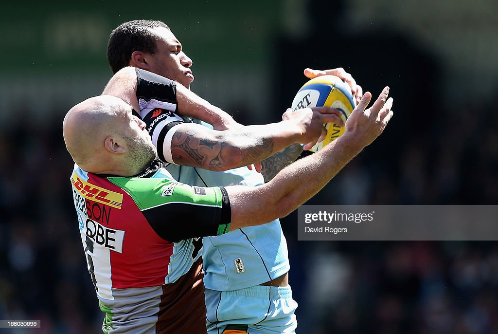 <a gi-track='captionPersonalityLinkClicked' href=/galleries/search?phrase=Courtney+Lawes&family=editorial&specificpeople=5385543 ng-click='$event.stopPropagation()'>Courtney Lawes</a> of Northampton wins the line out from George Robson during the Aviva Premiership match between Harlequins and Northampton Saints at Twickenham Stoop on May 4, 2013 in London, England.