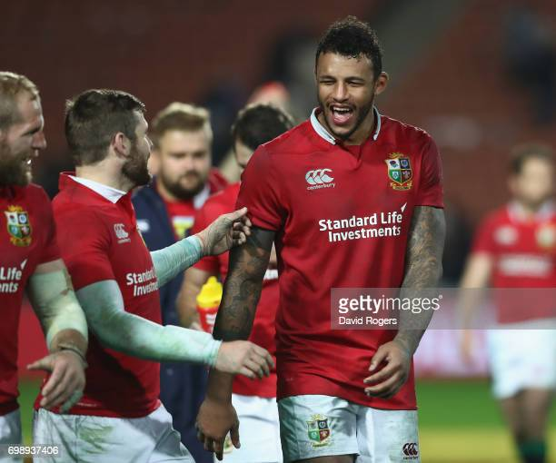 Courtney Lawes of the Lions celebrates victory with team mate Elliot Daly during the match between the Chiefs and the British Irish Lions at Waikato...