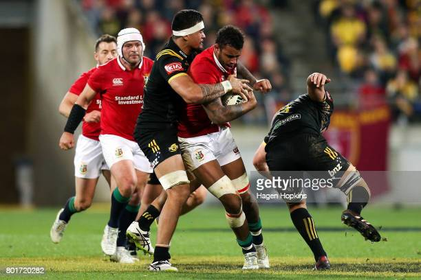 Courtney Lawes of the Lions is tackled by Vaea Fifita of the Hurricanes during the match between the Hurricanes and the British Irish Lions at...