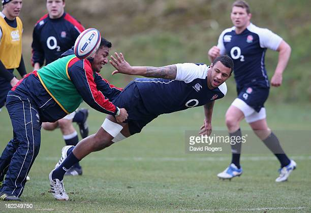 Courtney Lawes passes the ball during the England training session held at Pennyhill Park on February 21 2013 in Bagshot England