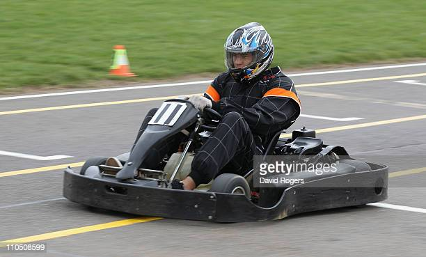Courtney Lawes the Northampton Saints and England flank forward drives a gokart during the Northampton Saints activity day on March 21 2011 in...