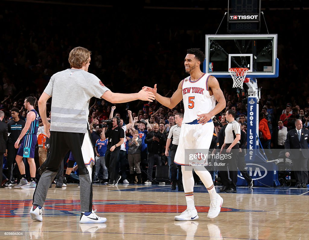 Courtney Lee #5 and Ron Baker #31 of the New York Knicks high five during the game against the Charlotte Hornets at Madison Square Garden in New York, New York.