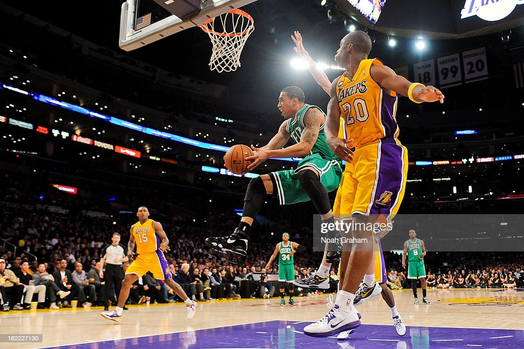 Courtney Lee #11 of the Boston Celtics attempts a reverse layup against Jodie Meeks #20 of the Los Angeles Lakers at Staples Center on February 20, 2013 in Los Angeles, California.