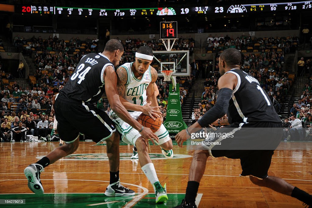 Courtney Lee #11 of the Boston Celtics attempts to drive past Carleton Scott #34 of the Brooklyn Nets on October 16, 2012 at the TD Garden in Boston, Massachusetts.