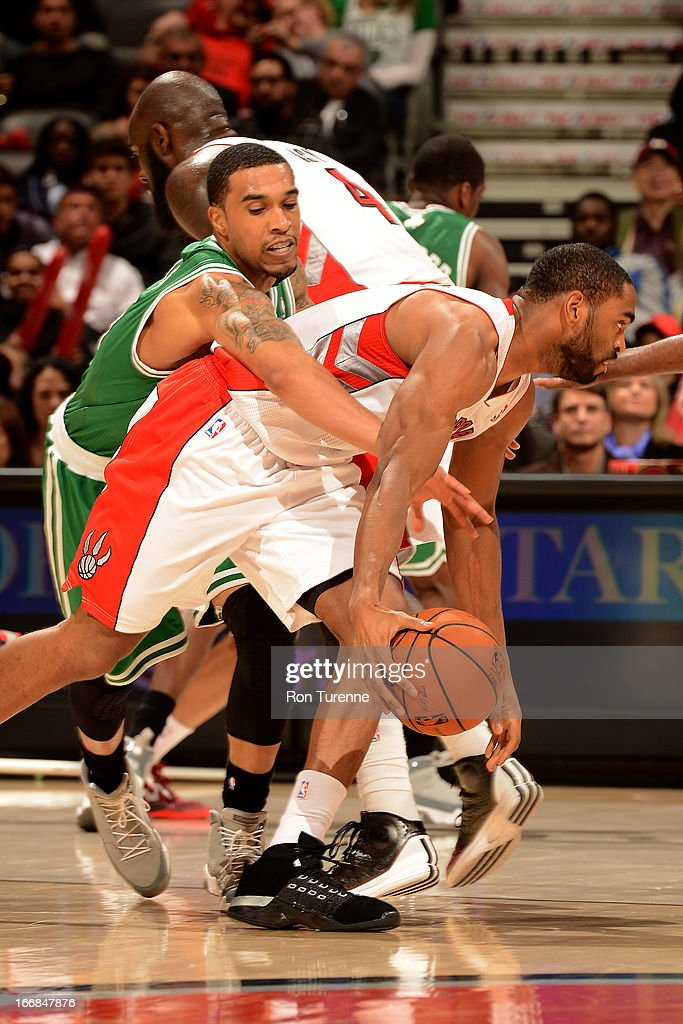 <a gi-track='captionPersonalityLinkClicked' href=/galleries/search?phrase=Courtney+Lee&family=editorial&specificpeople=730223 ng-click='$event.stopPropagation()'>Courtney Lee</a> #11 of the Boston Celtics attempts to steal the ball from <a gi-track='captionPersonalityLinkClicked' href=/galleries/search?phrase=Alan+Anderson&family=editorial&specificpeople=3945355 ng-click='$event.stopPropagation()'>Alan Anderson</a> #6 of the Toronto Raptors on April 17, 2013 at the Air Canada Centre in Toronto, Ontario, Canada.