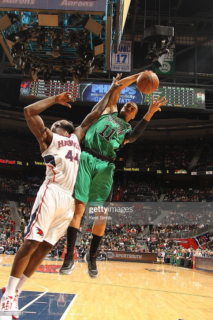 Courtney Lee #11 of the Boston Celtics battles for the rebound against Ivan Johnson #44 of the Atlanta Hawks at the Philips Arena on January 25, 2013 in Atlanta, Georgia.
