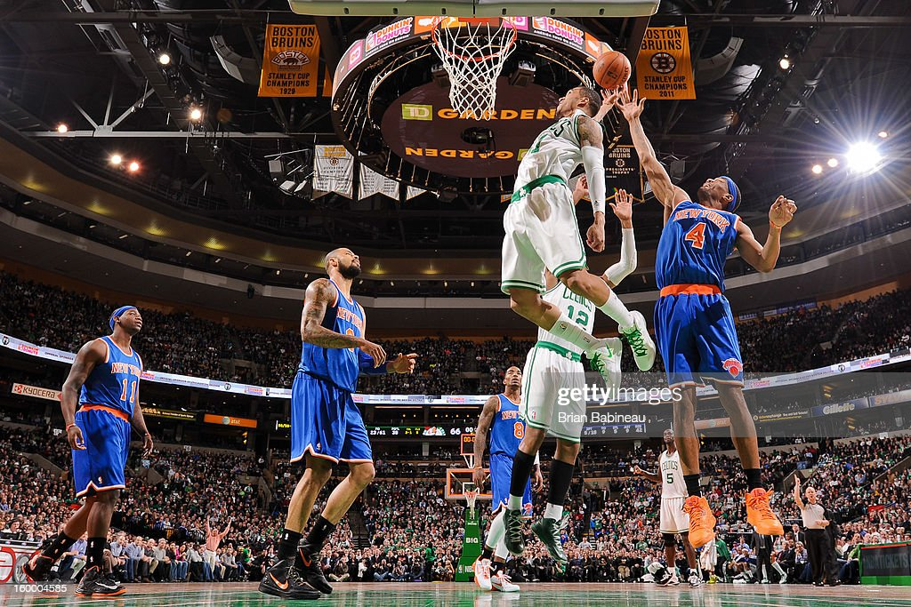 Courtney Lee #11 of the Boston Celtics drives to the basket against James White #4 of the New York Knicks on January 24, 2013 at the TD Garden in Boston, Massachusetts.