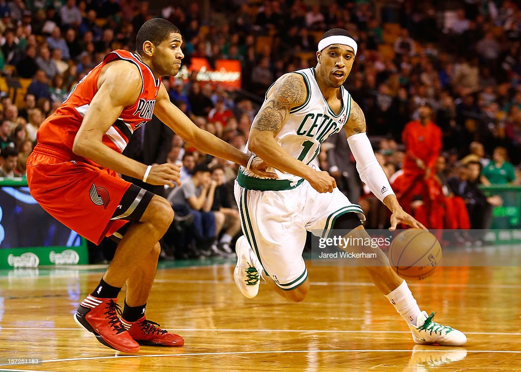 Courtney Lee #11 of the Boston Celtics drives to the basket in front of Nicolas Batum #88 of the Portland Trail Blazers during the game on November 30, 2012 at TD Garden in Boston, Massachusetts.