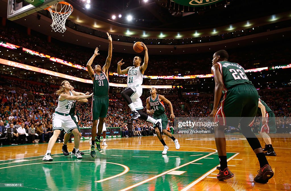 <a gi-track='captionPersonalityLinkClicked' href=/galleries/search?phrase=Courtney+Lee&family=editorial&specificpeople=730223 ng-click='$event.stopPropagation()'>Courtney Lee</a> #11 of the Boston Celtics drives to the basket in front of John Henson #31 of the Milwaukee Bucks in the first quarter during the home opener at TD Garden on November 1, 2013 in Boston, Massachusetts.
