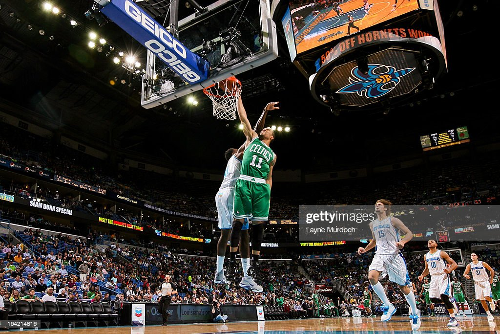 Courtney Lee #11 of the Boston Celtics dunks against Al-Farouq Aminu #0 of the New Orleans Hornets on March 20, 2013 at the New Orleans Arena in New Orleans, Louisiana.