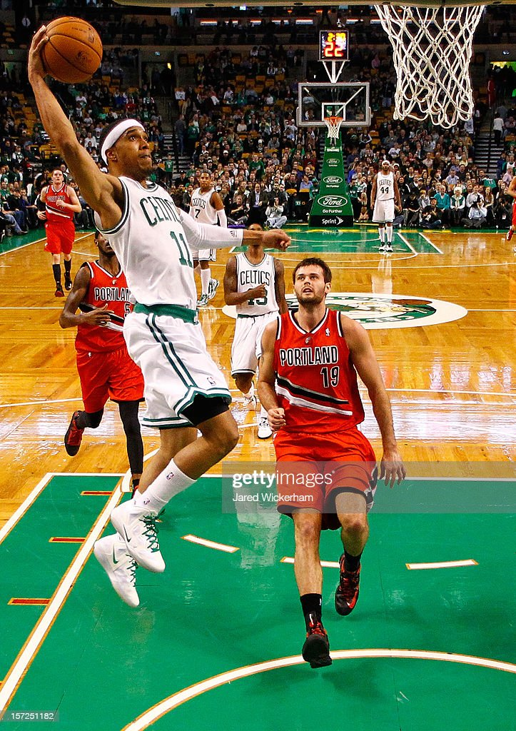 <a gi-track='captionPersonalityLinkClicked' href=/galleries/search?phrase=Courtney+Lee&family=editorial&specificpeople=730223 ng-click='$event.stopPropagation()'>Courtney Lee</a> #11 of the Boston Celtics dunks the ball in front of <a gi-track='captionPersonalityLinkClicked' href=/galleries/search?phrase=Joel+Freeland&family=editorial&specificpeople=757235 ng-click='$event.stopPropagation()'>Joel Freeland</a> #19 of the Portland Trail Blazers during the game on November 30, 2012 at TD Garden in Boston, Massachusetts.