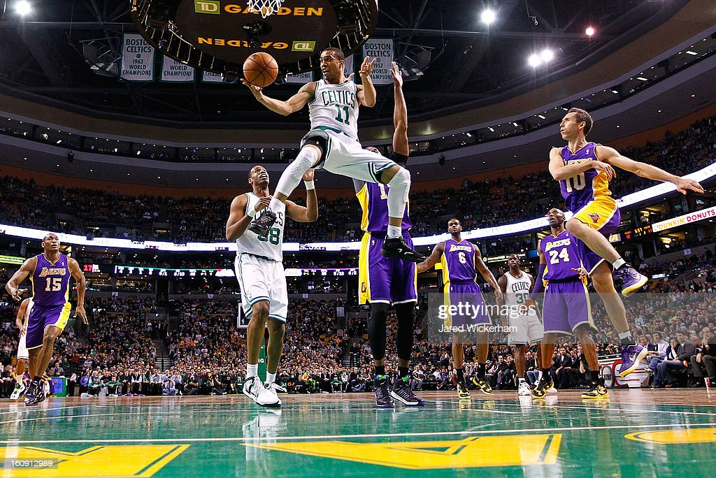 <a gi-track='captionPersonalityLinkClicked' href=/galleries/search?phrase=Courtney+Lee&family=editorial&specificpeople=730223 ng-click='$event.stopPropagation()'>Courtney Lee</a> #11 of the Boston Celtics goes midair underneath the basket for a pass in front of <a gi-track='captionPersonalityLinkClicked' href=/galleries/search?phrase=Dwight+Howard&family=editorial&specificpeople=201570 ng-click='$event.stopPropagation()'>Dwight Howard</a> #12 of the Los Angeles Lakers during the game on February 7, 2013 at TD Garden in Boston, Massachusetts.